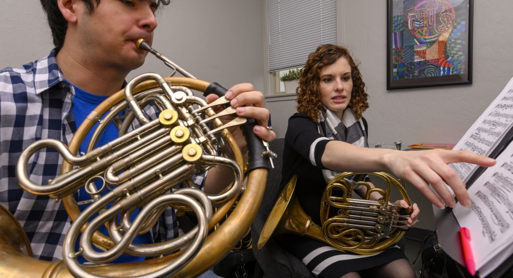 Conservatory faculty teaching a horn lesson